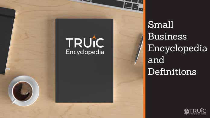 """Black book on desktop with title """"T R U I C Encyclopedia"""""""