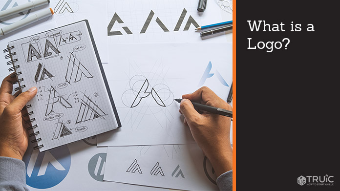 A designer sketching a logo design on a piece of paper.