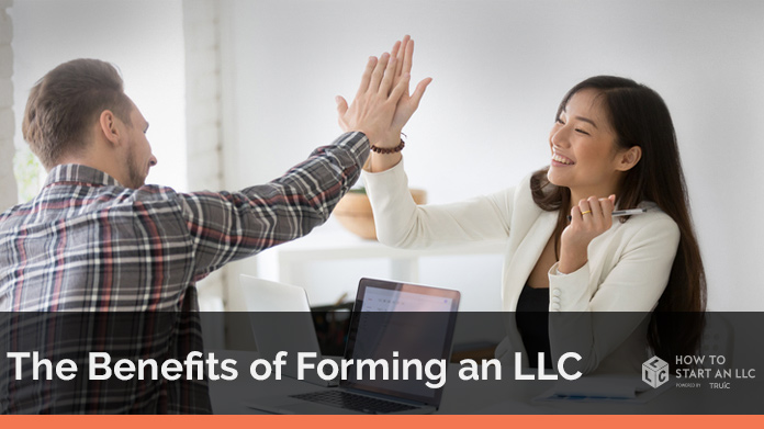 Business owners celebrating LLC benefits with a high five.