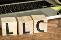 Wooden Blocks with letters on them saying L L C