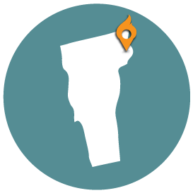 Small map with pin depicting Burlington, VT