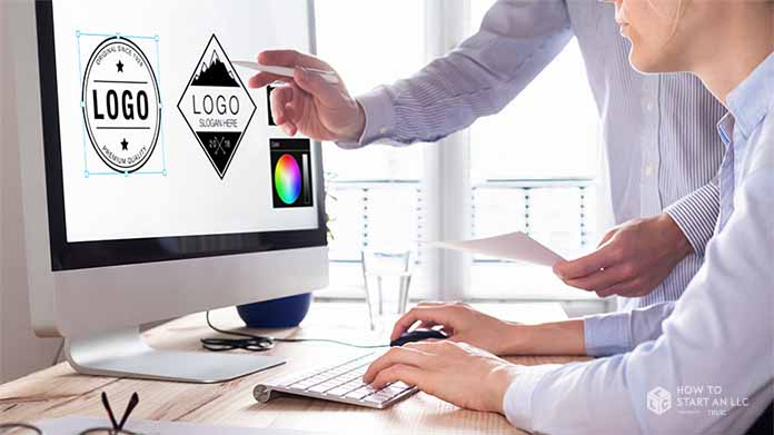 Two entrepreneurs looking at logos on a screen