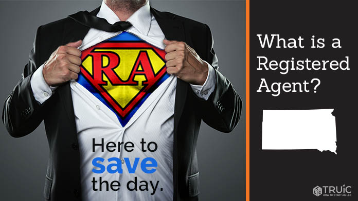 """A man pulling back his shirt to reveal a """"R A"""" superhero costume"""