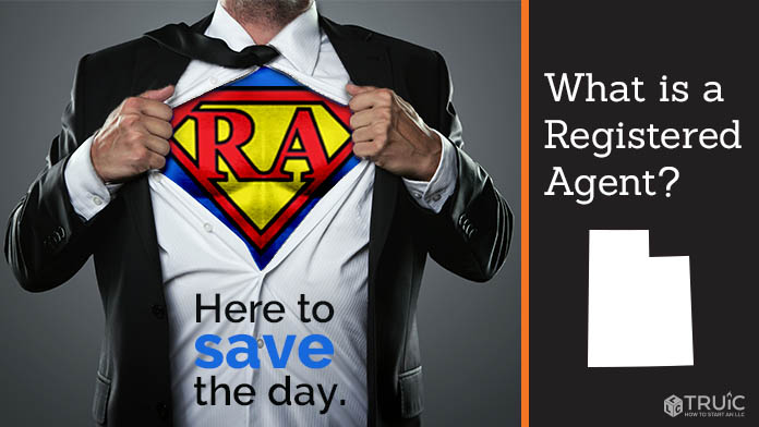 "A man pulling back his shirt to reveal a ""R A"" superhero costume"