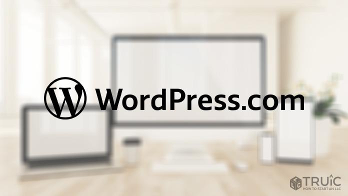 WordPress.com logo over blurred background.