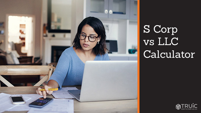 Woman working at her desk on an S corp vs L L C calculator.