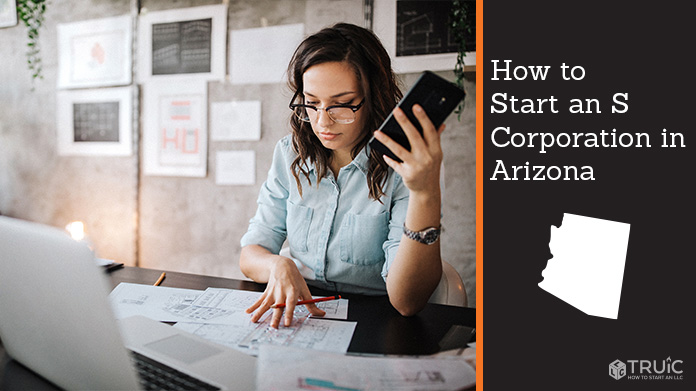 Woman looking over paperwork to start an S corporation in Arizona.
