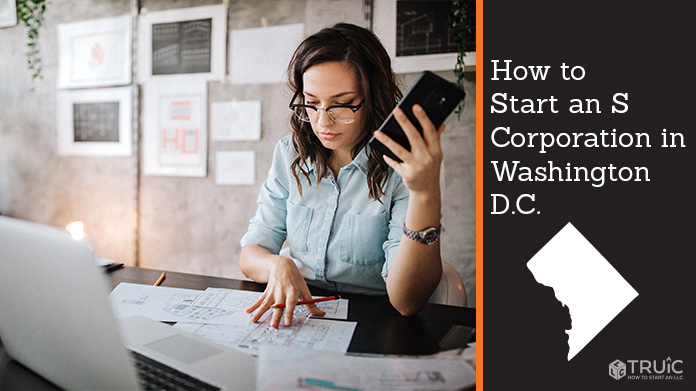 Woman looking over paperwork to start an S corporation in Washington DC