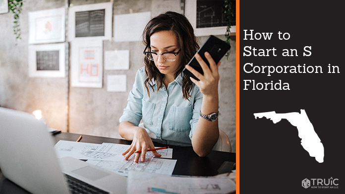 Woman looking over paperwork to start an S corporation in Florida