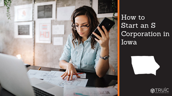 Woman looking over paperwork to start an S corporation in Iowa.
