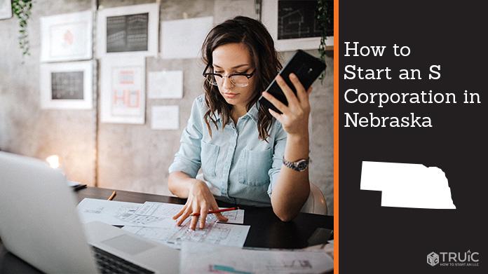 Woman looking over paperwork to start an S corporation in Nebraska.