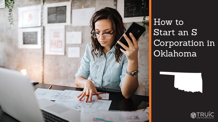 Woman looking over paperwork to start an S corporation in Oklahoma.