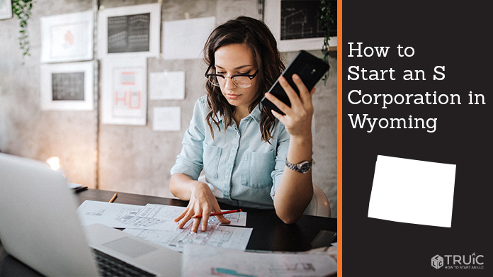 Woman looking over paperwork to start an S corporation in Wyoming