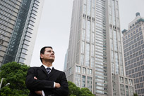 man standing amongst skyscrapers